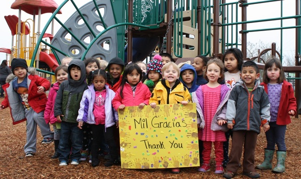 children in park with thank you 2